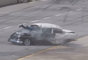1955 Chevy crashes on the drag strip, ends with driver's legs sticking out windshield
