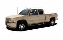 "2004 GMC Sierra Denali Ext Cab 143.5"" WB Angular Front Exterior View"