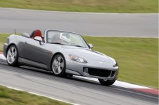 2009 Honda S2000 driving on a racetrack