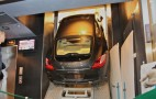 Porsche Panamera squeezed into elevator for  94th story presentation