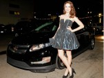 Alison Brie with 2011 Chevy Volt at Global Green Pre-Oscar Party, Feb 2011