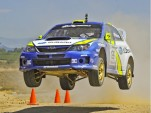 2011 Subaru Rally Team race car at speed