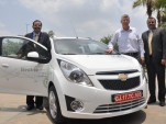Chevrolet Beat EV electric vehicle with GM executives, India, June 2011