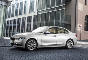 BMW 330e comes for Tesla Model 3 in new ads: Does it miss?