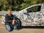 Chief engineer Andrew Farah with camouflaged 2016 Chevrolet Volt prototype