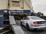2016 Ford Mustang being loaded on a ship for export