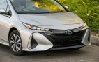 How does the heat pump work in a Toyota Prius Prime plug-in hybrid?