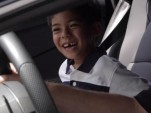 A 7-year-old boy is given a birthday ride in a Lamborghin Aventador