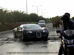 A Bugatti Veyron tackles a speed bump.