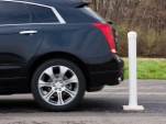 A Cadillac SRX demonstrates Rear Automatic Braking - image: John F. Martin for Cadillac