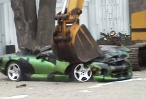 A Dodge Viper donated for educational purposes being crushed