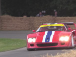 A Ferrari F40 LM takes to the Goodwood hill climb at the Festival of Speed