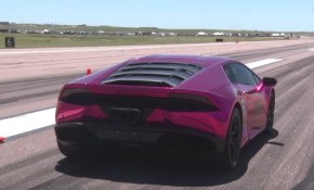 A Lamborghini Huracan blasts down the runway en route to a new speed record