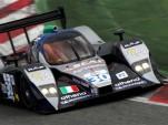 A Lola Le Mans Prototype car on track