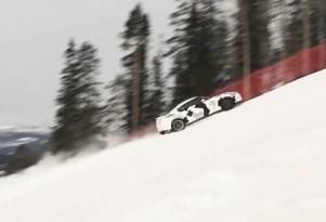 A Nissan GT-R drives up a ski slope