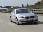 A semi-autonomous BMW 5 Series, on the highway outside of Munich