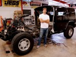 Artist Jeremy Dean with half a Hummer H2 for his work, &quot;Back to the Futurama,&quot; January 2010