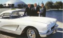 Astronaut Alan Shepard (center) with GM reps and his 1962 Corvette