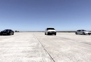 When a Tesla Model S and Ferrari drag-race an electric van...what happens?