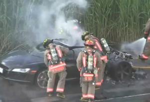 Audi R8 fire subdued by firefighters on Toronto highway