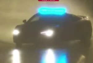 Audi R8 safety car drifts in rain at 24 Hours of Le Mans.