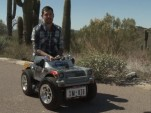 Austin Coulson riding the world's smallest car