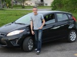 New-car owner John Knox with his 2011 Ford Fiesta SE hatchback, May 2011