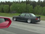 BMW E30 M3 with a V-10 engine pulls away from a Lamborghini Huracan