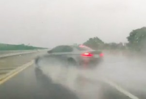 BMW M3 Coupe crashes in the wet