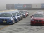 BMW M5s and M6s, lined up for track day action at Laguna Seca