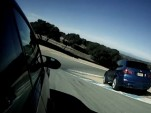 BMW's X5M takes the shortest line through Laguna Seca's corkscrew.
