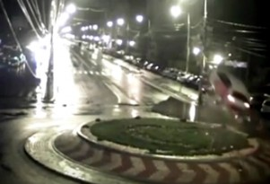 Car in Romania flies over roundabout