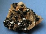 Cassiterite, mined in Tasmania. Image: Ralph Bottrill