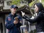 Celina Jade shows Sebastian Vettel some martial arts techniques