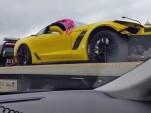 Crashed 2015 Chevrolet Corvette Z06 on a flatbed in Chicago