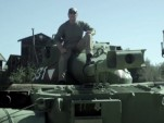 Crush things in a tank with Arnold Schwarzenegger