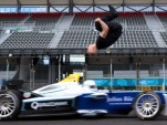 Damien Walters backflip over a moving Formula E race car