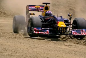 David Coulthard plays in the Texas dirt. Image: Red Bull