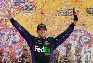 Denny Hamlin celebrates his second 2012 win at Kansas - NASCAR photo