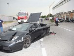 Destroyed Murcielago, in front of destroyed BMW dealership - image courtesy La Provincia