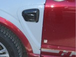 detail of spy shot showing GM Two-Mode Plug-In Hybrid being tested in Saturn Vue mule