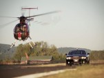 Dodge Challenger SRT8 versus an MD 500-D helicopter