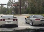 Drivers of C6 and C5 Chevrolet Corvettes participate in public road drag race
