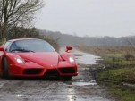 Ferrari Enzo supercar in the mud