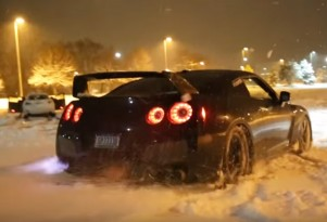 Fire breathing Nissan GT-R playing in the snow