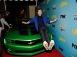 GLEE's Chris Colfero on the hood of a Chevrolet Camaro