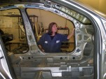 GM corrosion engineer Christa Cooper inspects a Cruze body shell for rust. Image: © GM Corp.
