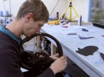 Hand-stitching the leather panels on the Agera R's steering wheel