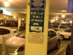 Handicapped parking space Shares Room With Electric Car Charging Station