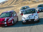 Honda Fit and Mazda2 B-Spec with production models - Photo courtesy Mazdaspeed